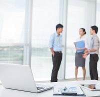 three business people talking