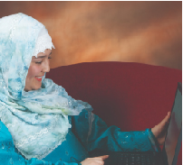 middle eastern woman holding a laptop